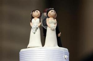 Two bride figurines adorn the top of a wedding cake during an illegal same-sex wedding ceremony in central Melbourne