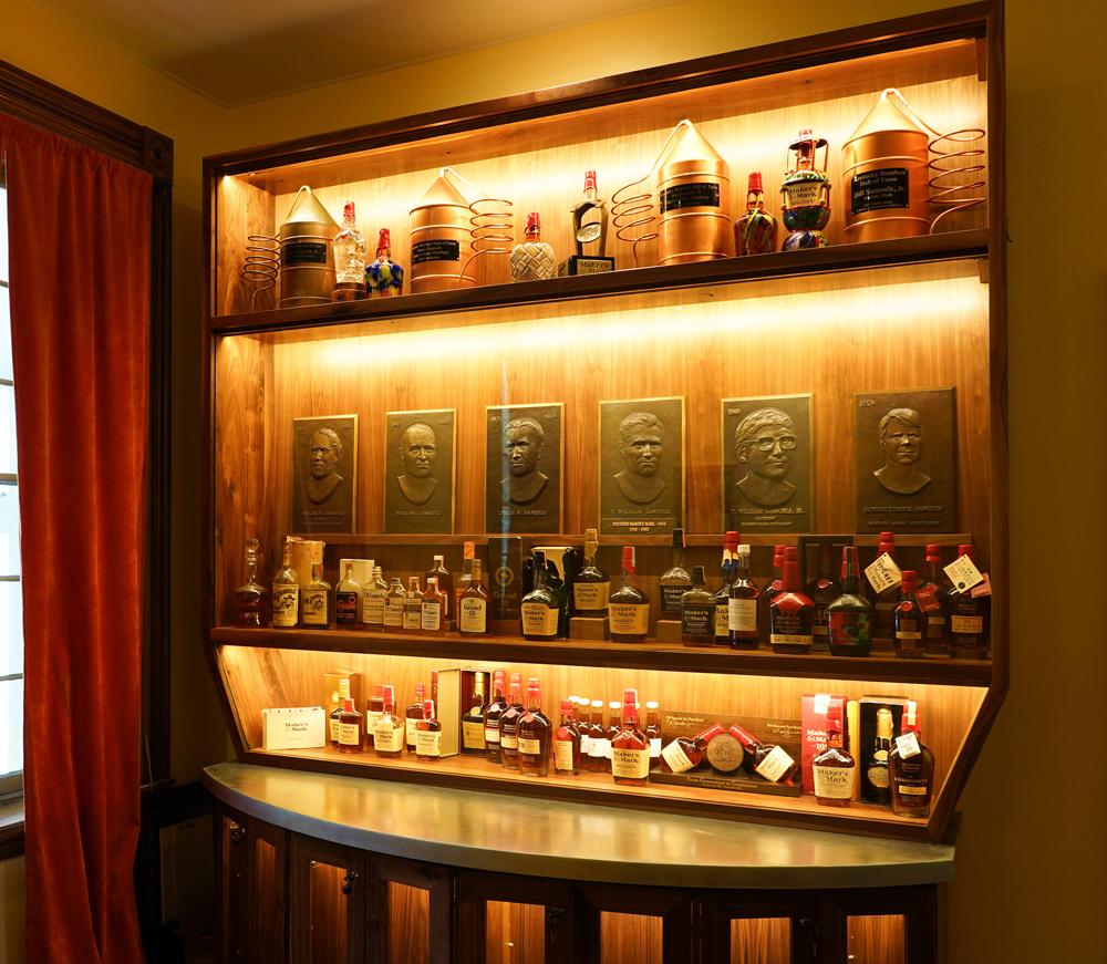 Historic bottles behind glass